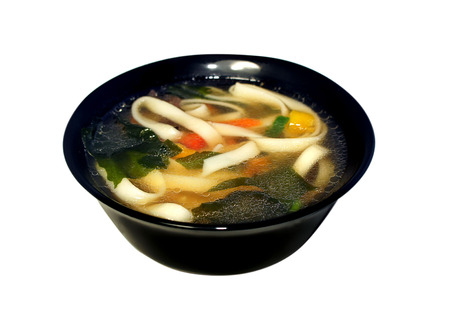 Miso soup with pasta, wakame seaweed, noodles and vegetables photo
