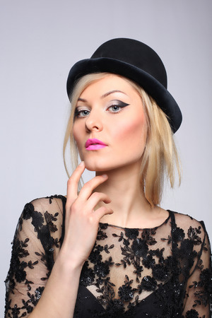beautiful young blonde woman in black hat