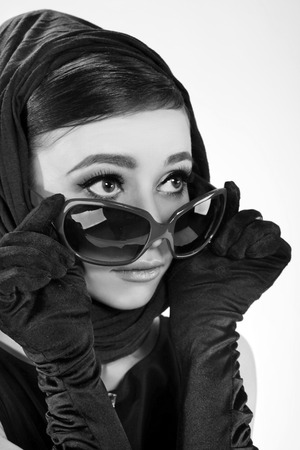 beautiful brunette woman in a retro style with sunglasses