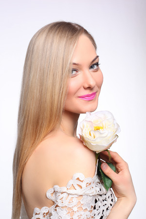 beautiful young girl with a white rose 版權商用圖片