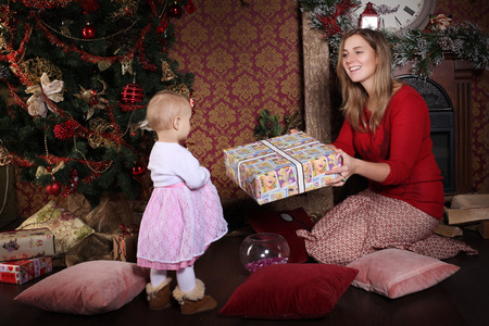 Christmas Mom gives daughter gift photo