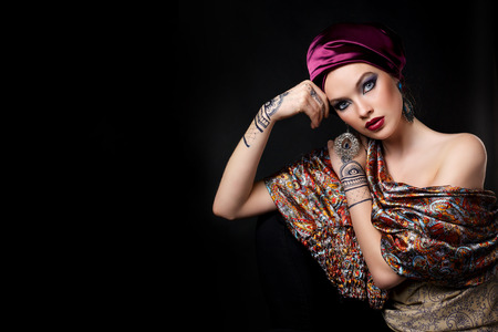 indian tattoo: beautiful woman in oriental style with mehendi in hijab
