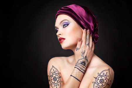 gorgeous girl: beautiful woman in oriental style with mehendi in hijab
