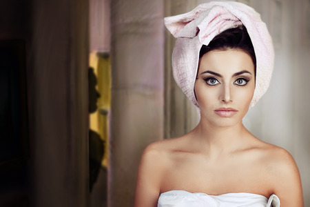 woman with a towel in her head photo