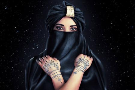 arab model: beautiful stylish woman in oriental style in turban