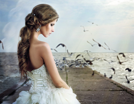 white dresses: SAD BRIDE walks on the beach