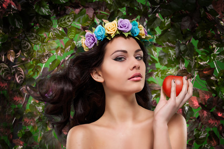 sexy naked girl: beautiful girl with a wreath on his head with apple