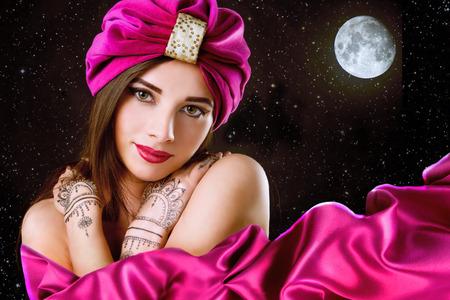 beautiful woman in oriental style in turban Zdjęcie Seryjne