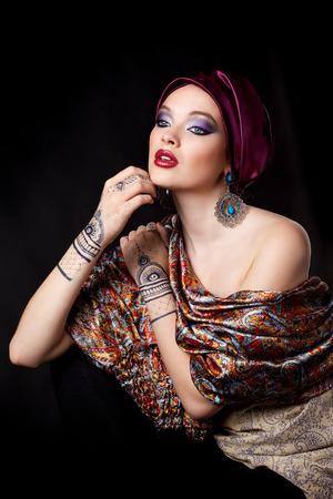 bollywood woman: beautiful woman in oriental style with mehendi in hijab