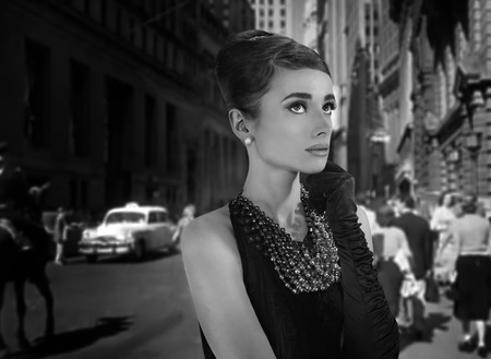 classy woman: beautiful young woman in retro style in old town Stock Photo