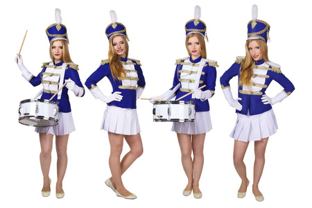 march band: beautiful blond woman cheerleade drummer isolated on white background Stock Photo