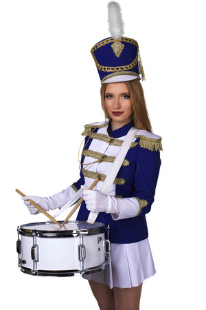 drummer: beautiful blond woman cheerleade majorette drummer isolated on white background