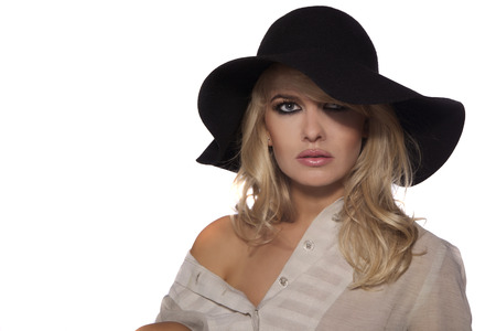 black hat: portrait of a beautiful blonde in retro style isolated on white background. in black hat Stock Photo