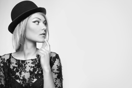 close portrait of beautiful blond woman in retro vintage style . copy space. black and white.