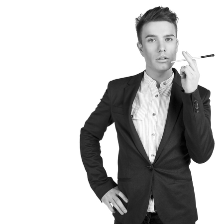 portret: portret of stylish young men with make up brush in the studio isolated on white background. copy space.
