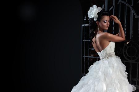 cinderella dress: Beautiful brunette bride in black background. copy space. Stock Photo