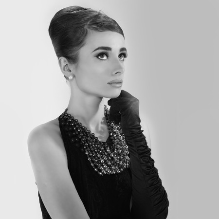 sixties: beautiful young woman in retro style . copy space.