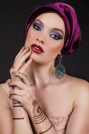 gorgeous: beautiful woman in oriental style with mehendi in hijab