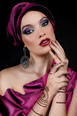 mehendi: beautiful woman in oriental style with mehendi in hijab