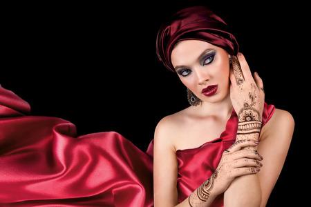 sexy asian woman: beautiful woman in oriental style with mehendi in hijab