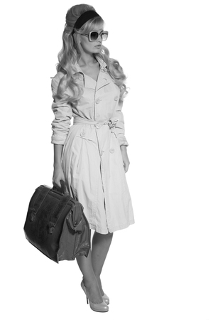 trench: portrait of a beautiful blonde in retro style isolated on white background. in trench coat. Stock Photo