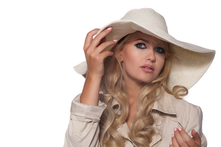 trench coat: portrait of a beautiful blonde in retro style isolated on white background. in trench coat. Stock Photo