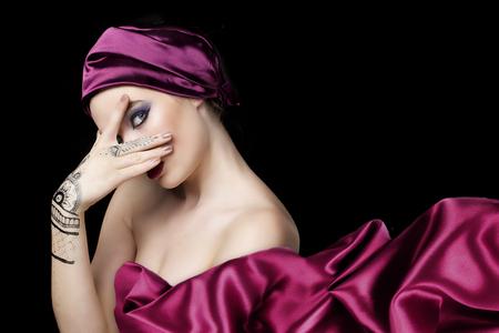 mehendi: beautiful woman in oriental style with mehendi in hijab
