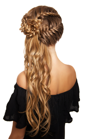 hair braid: portrait of a beautiful young blonde woman on a light background with hairdo on her head. copy space.