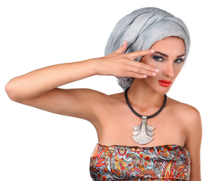 turban: beautiful stylish woman in oriental style  wearing in turban isolated in white background
