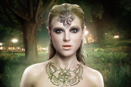magical forest: beautiful elf woman in a magical forest Stock Photo
