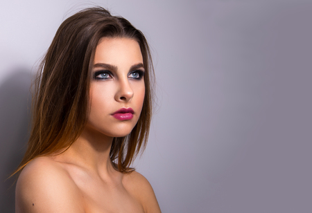 Fashionable portrait of a girl model. Fashion, smoky eyes makeup.