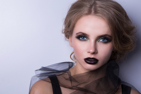 Beauty Fashion Model Woman , portrait,  lady with black lips. Concept Girl face with perfect skin in bright Background