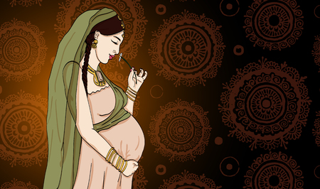 buddha lotus: indian pregnant woman in pregnancy dress is prepared for maternity. waiting for a baby birth