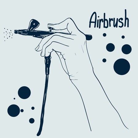 Hand holding a professional airbrush. can be used as logo. Stock Photo