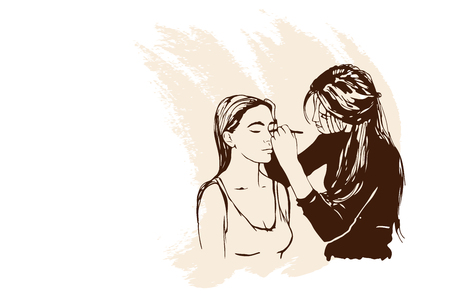 Woman visagist makeup artist paints on the face of his client. Illustration   Stock Photo