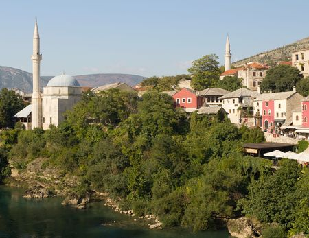 mehmed: Koski Mehmed Pasa Mosque and Colorful Shops in Historic Old Town of Mostar, Bosnia and Herzegovina Stock Photo