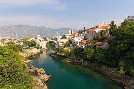 View of Old Bridge on the Neretva River in Historic Mostar, Bosnia and Herzegovina photo