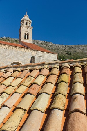 Rust colored Roof Tiles in Front of Church in Historic Old Town of Dubrovnik, Croatia photo