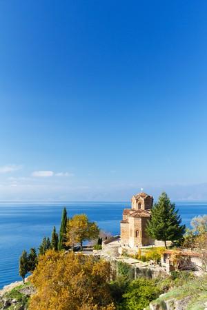 the balkan: St. Jovan Church Overlooking Lake Ohrid on Sunny Autumn Day in Macedonia Stock Photo