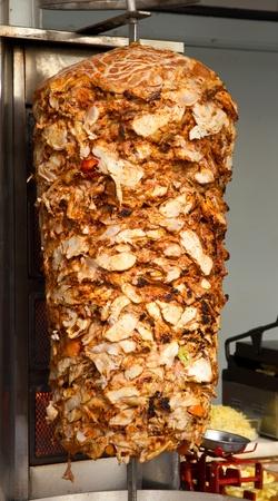 donner: Chicken Cooking on Rotating Vertical Spit for Turkish Doner Kebab