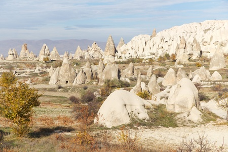 Carved Rock Homes Known as Fairy Chimneys in Valleys of Cappadocia, Anatolia, Central Turkey photo