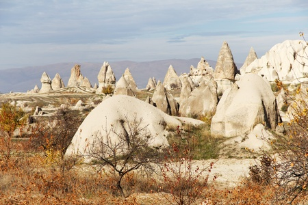 Homes Carved into Unique Volcanic Rock Formations, Known as Fairy Chimneys, in Cappadocia, Anatolia, Turkey photo