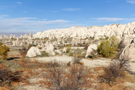 Interesting Rock Formations and Cave Homes in a Valley Outside the Town of Goreme in Cappadocia, Anatolia, Central Turkey photo