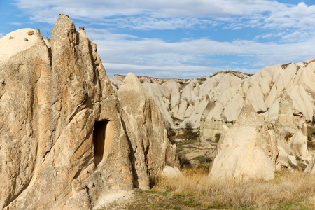 Unique Rock Formations With Carved Homes Known as Fairy Chimneys in Swords Valley Near Goreme in Cappadocia, Central Turkey photo