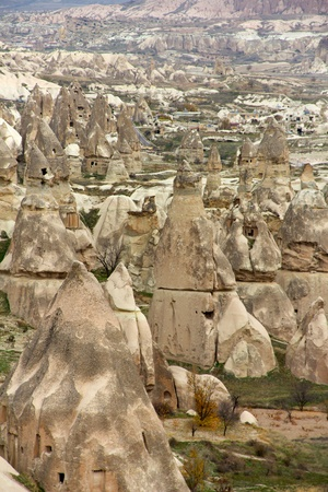 Unique Rock Homes Called Fairy Chimneys in Valley Near Goreme in Cappadocia, Central Turkey photo