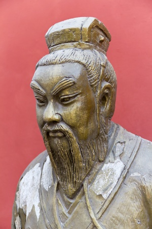Old Statue of Chinese Man Outside the Confucius Temple in Beijing, China photo
