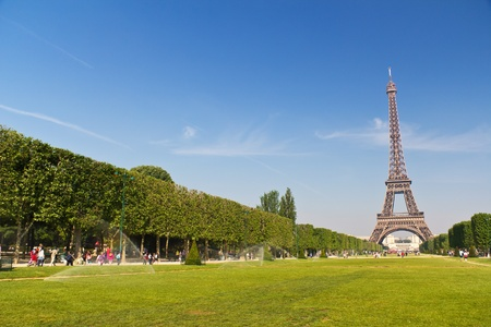 iconic: Tourists and Locals enjoying the iconic Eiffel Tower in Paris, France Editorial