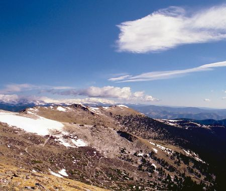 Rocky Mountain National Park features majestic mountain views, a variety of wildlife, varied climates and environments—from wooded forests to mountain tundra—and easy access to back-country trails and campsites. The park is located north-west of Boulder,  photo