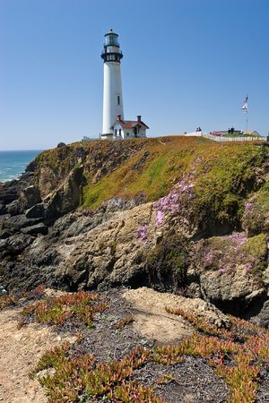 Pigeon Point Light Station is a lighthouse built in 1871 to guide ships on the Pacific coast of California. It is one of the tallest lighthouses in the United States. It is still an active Coast Guard aid to navigation. Pigeon Point Light Station is locat photo