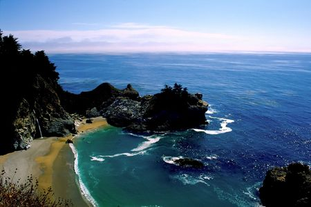 mcway: Big Sur is a sparsely populated region of the central California, United States coast where the Santa Lucia Mountains rise abruptly from the Pacific Ocean. The terrain offers stunning views, making Big Sur a popular tourist destination.